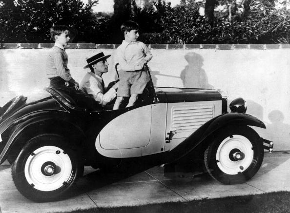 California, USA, 9th March, 1932, Silent film star Buster Keaton about to take his two sons Bob and Joe for a ride in his car in Hollywood